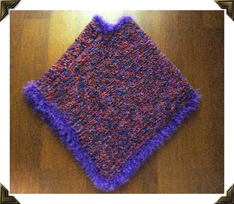 This is a recent little poncho with homespun yarn and fun fur.
