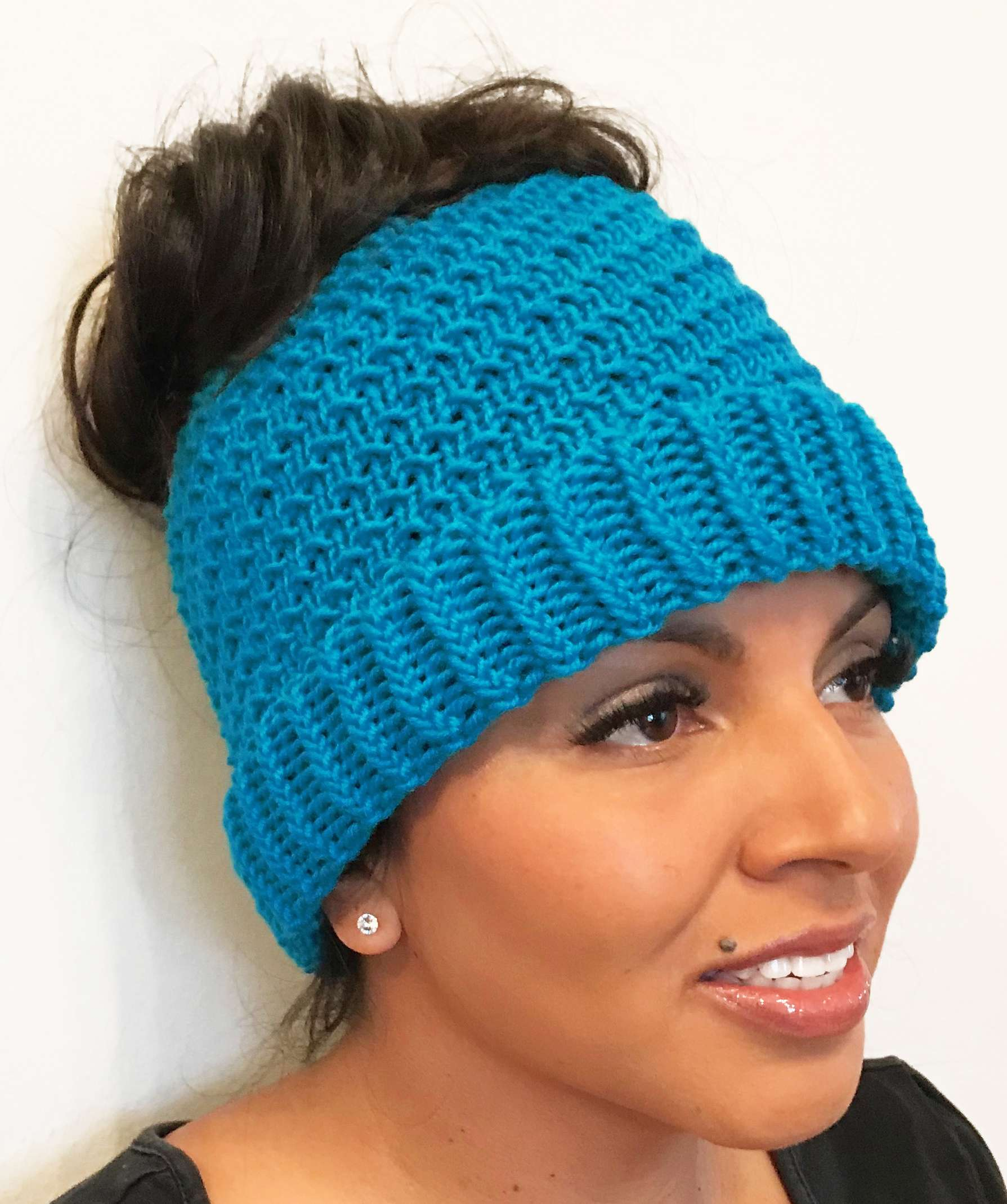ddf9524b1f1 Aria Messy Bun Beanie. Let s start the year off by going back to basics  with a twist! This beanie incorporates the ewrap knit stitch